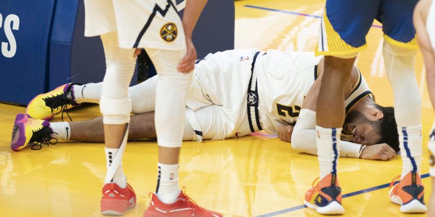 Jamal Murray goes down with apparent knee injury, team awaits MRI