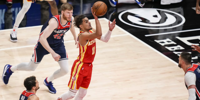 Hawks clinch playoff berth behind Trae Young's 33 points