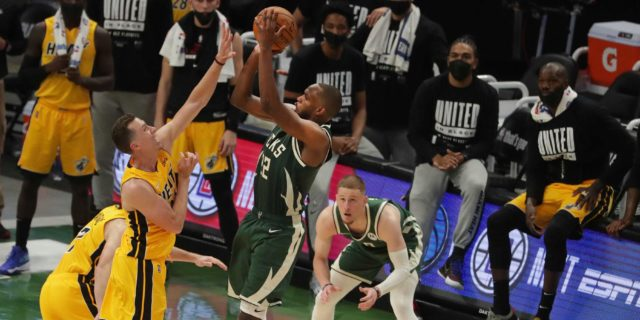 Khris Middleton lifts Bucks past Heat in overtime in Game 1