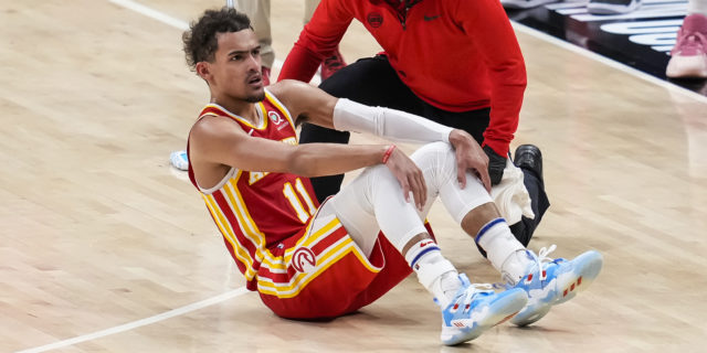 All eyes on Trae Young's ankle after freak encounter with ref