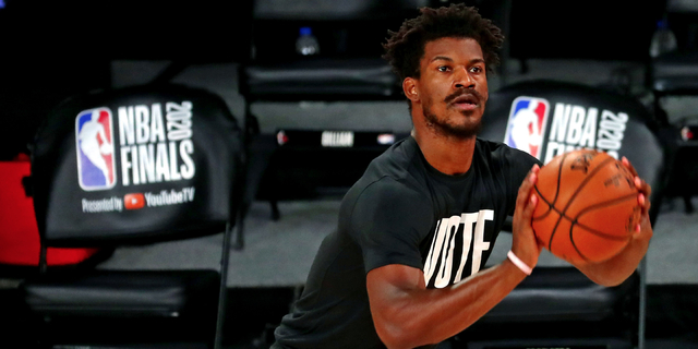 Heat's Butler rolls ankle, will stay in game